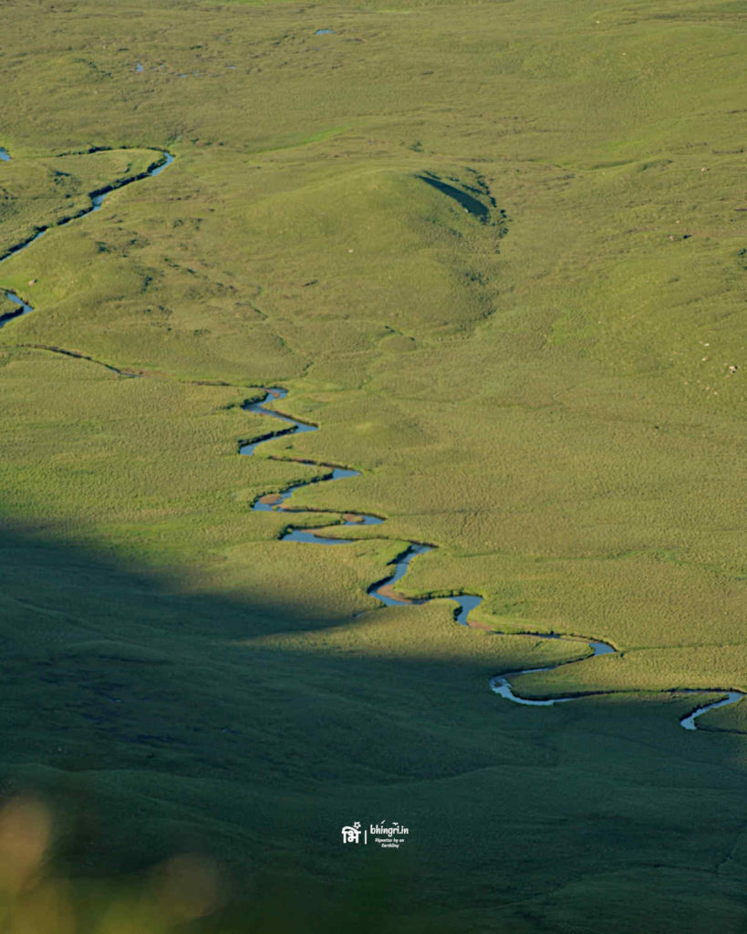 Lealt river meanders through the hilly terrain, twisting and turning