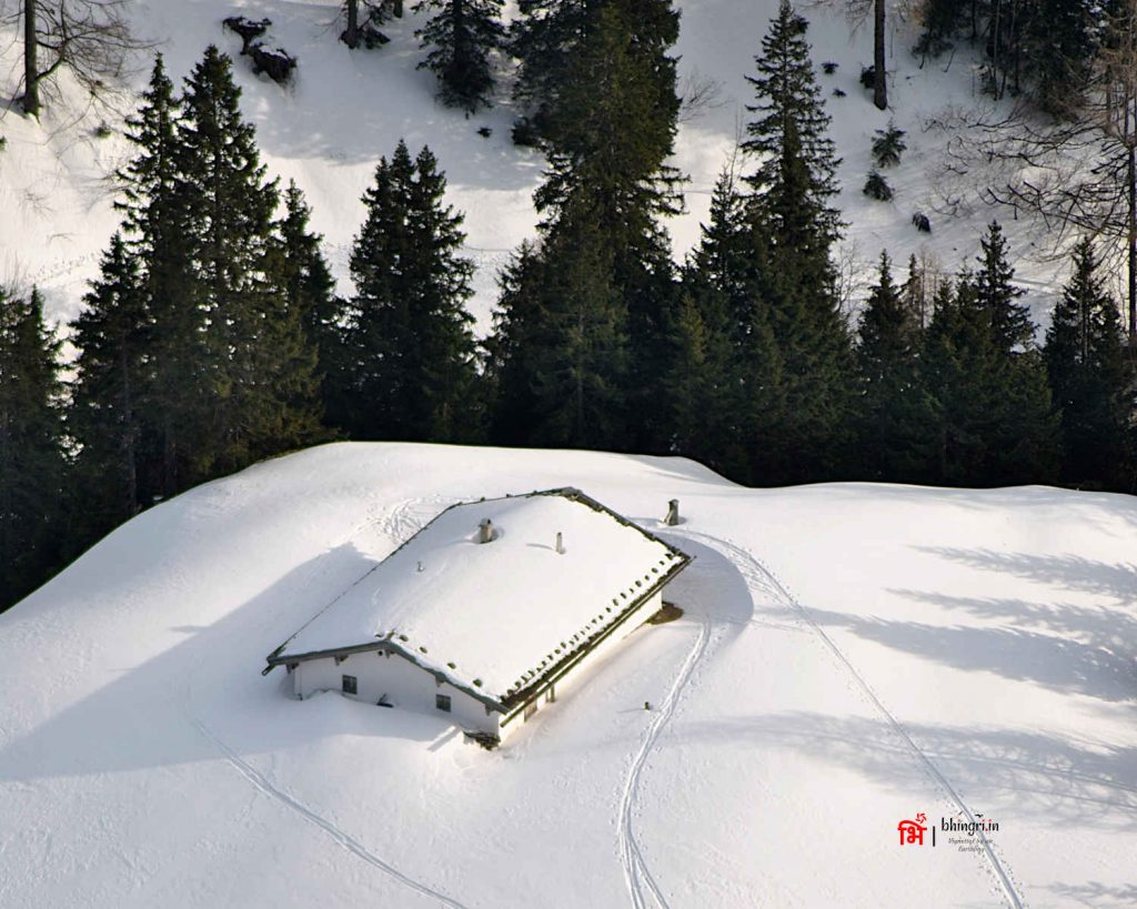 A house buried under snow